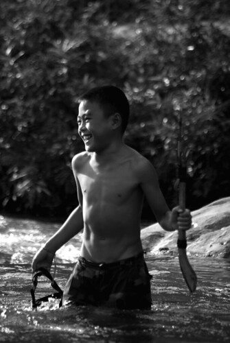 Young Fisherman, Mekong Laos | by The Hungry Cyclist