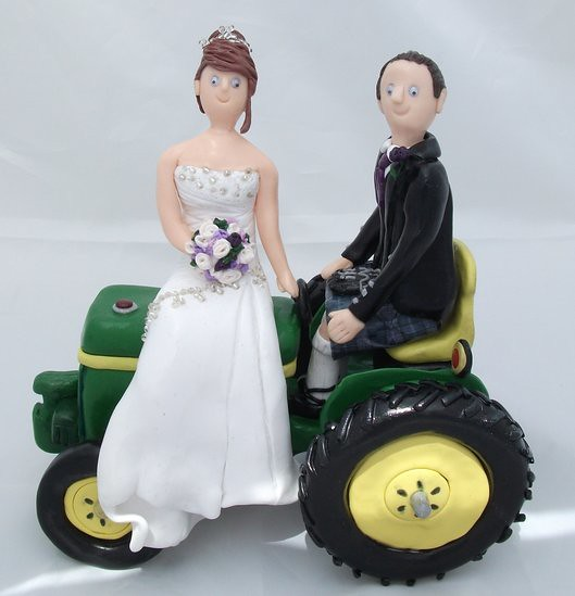 Wedding Cake Toppers on Tractor | A bride a groom and their … | Flickr