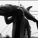 a fisherman carrys a giant black marlin  on his  shoulder on the way to tungkang fishmarket, southern taiwan.