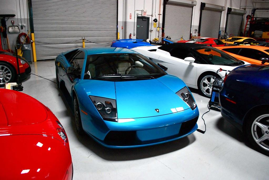 two Bugatti Veyron Lamborghini Ferrari Ford GT ...