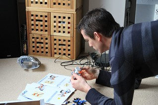 Ben figuring out how to make his Lego robot | by ::Christine::