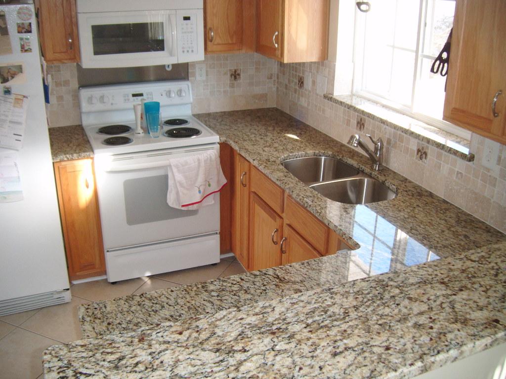 Granite with tile backsplash