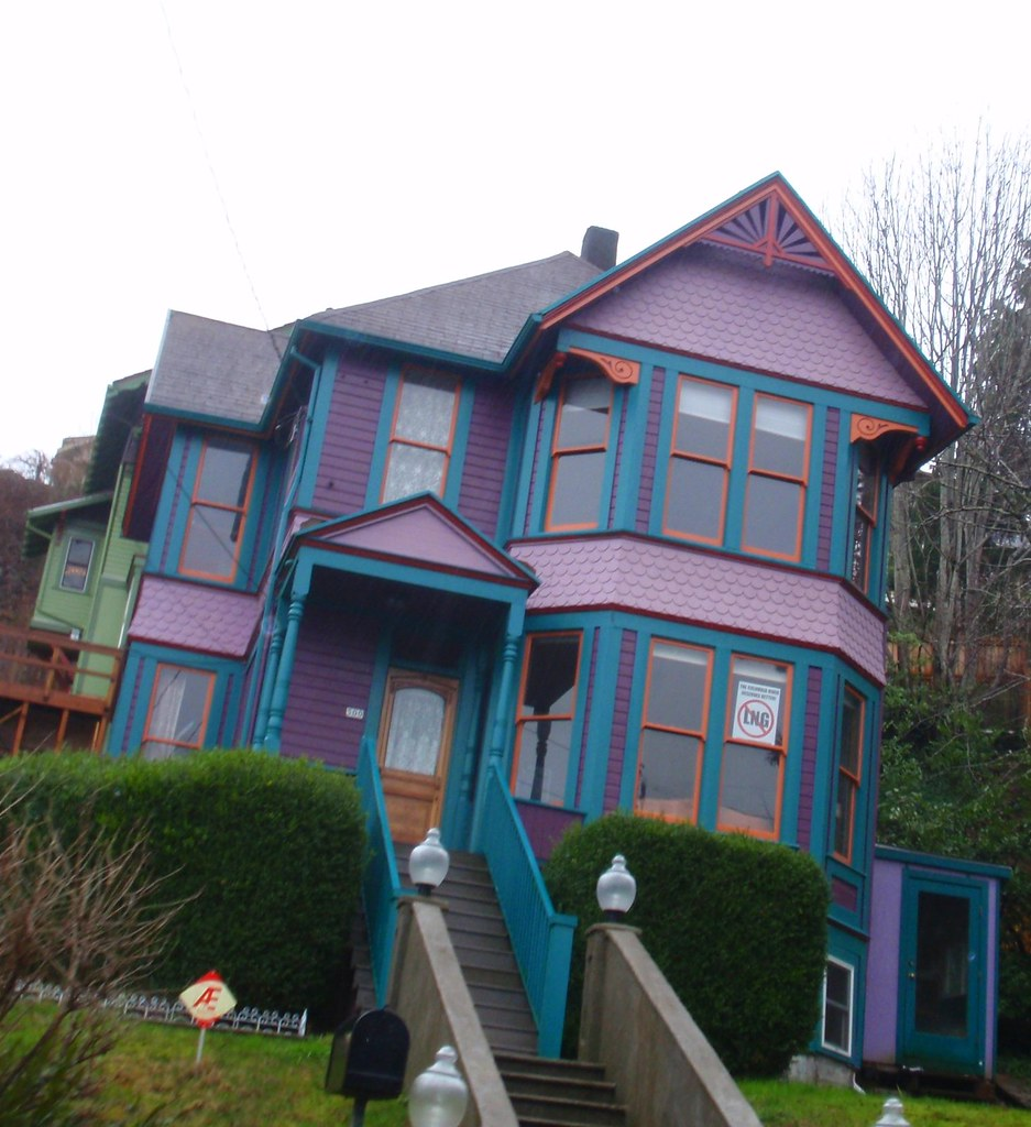 Purple, teal, lavender and orange Victorian house | Eli