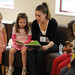 CI student and VCRA volunteers read to children during the 4th annual Children's Reading Celebration & Young Authors' Fair