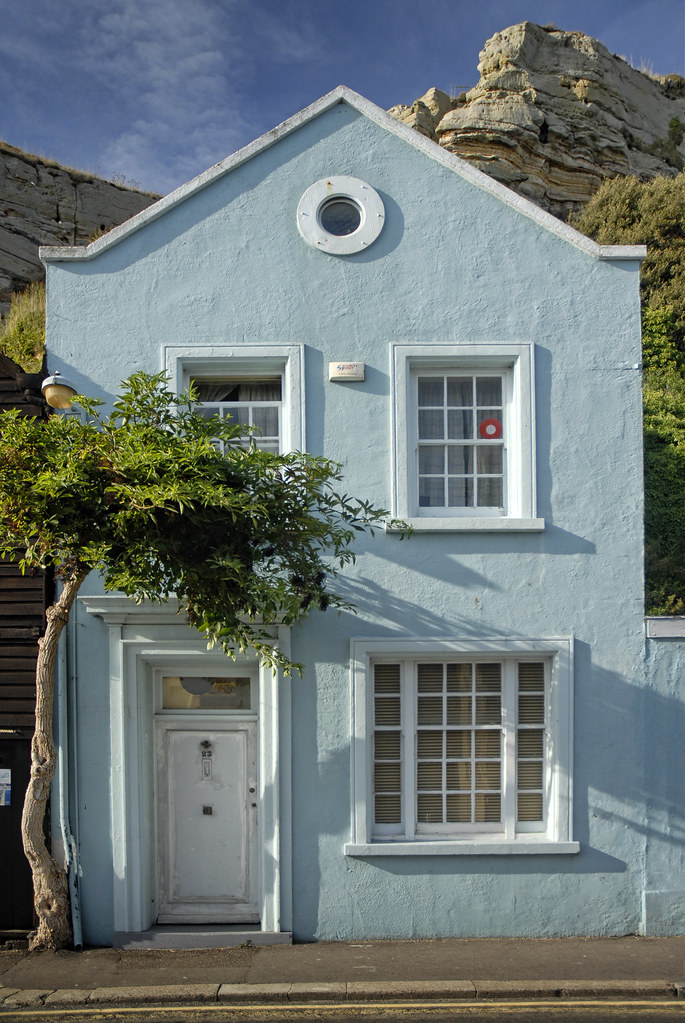Uk hastings blue house this lovely little house is - White exterior paint color schemes ...