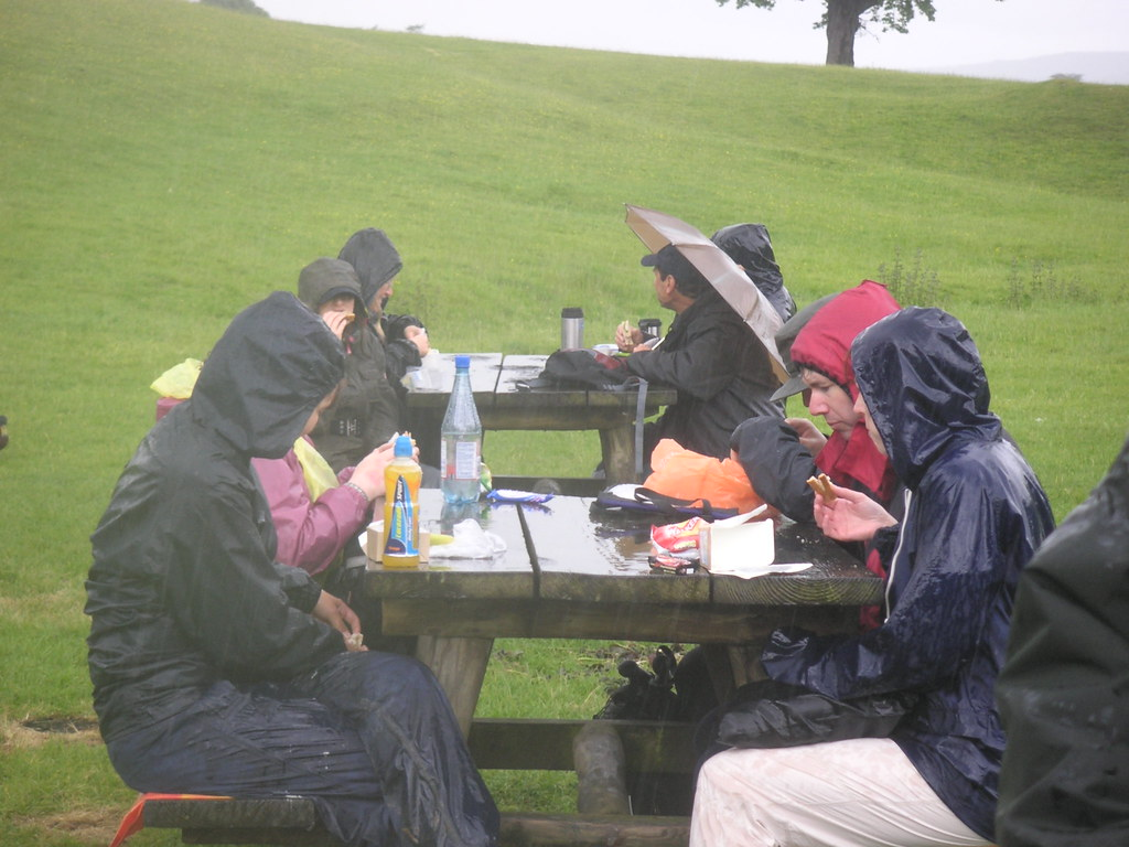 Eating In The Rain A Group Of Hikers Eating Lunch In