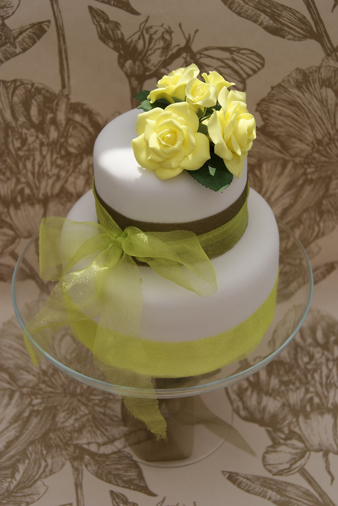 white wedding cake with yellow roses yellow roses wedding cake made sugar roses in 27426