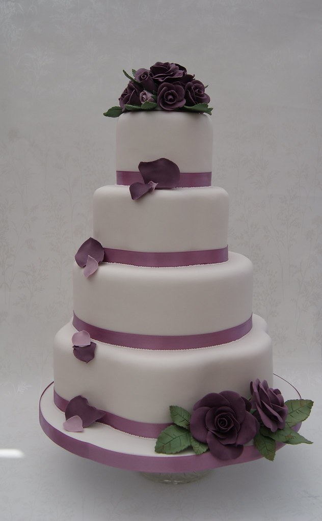wedding cake with rose petals cascading petal wedding cake four tier wedding cake 26958