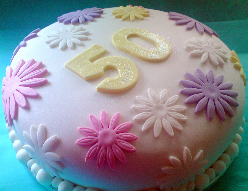 Pastel Flower Covered 50th Birthday Cake