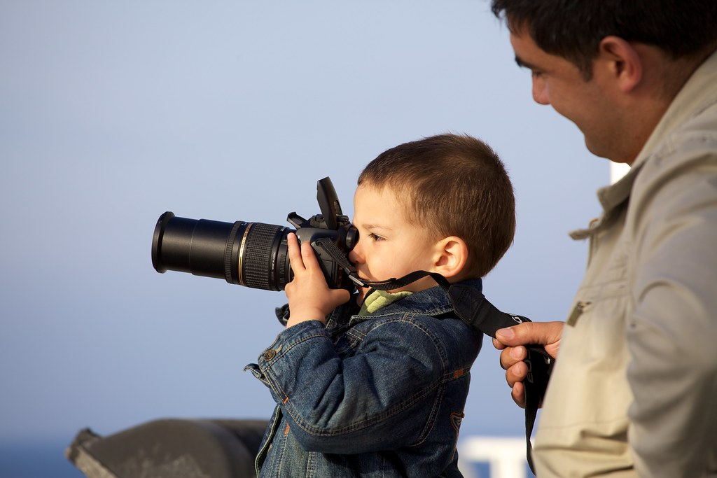Kid Taking Pictures On the Ferry to Majorca | Duncan Rawlinson ...