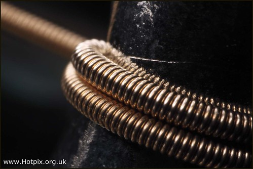acoustic guitar string wound around neck an extreme macro flickr. Black Bedroom Furniture Sets. Home Design Ideas
