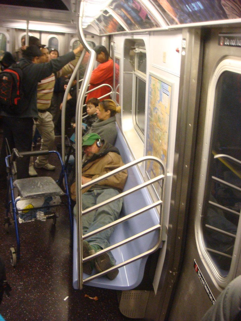 smelly dude reclined on a crowded subway car this may be t flickr. Black Bedroom Furniture Sets. Home Design Ideas