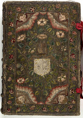 17th century embroidered Canvas book, pictorial angel and floral motif  with two red ribbons. | by Aria Nadii