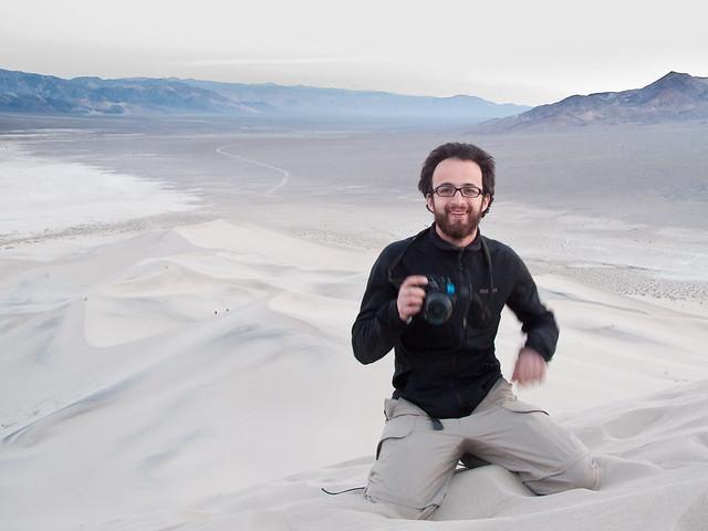 Photographe dans le sable