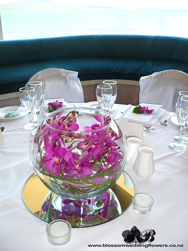 Orchid fishbowl wedding reception table flowers