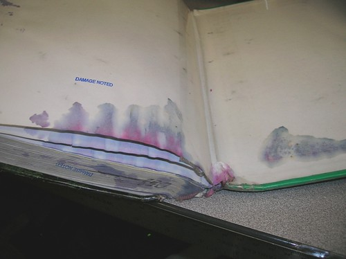 Liquid Damaged Textbook | by Enokson