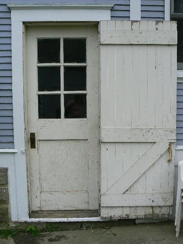 house door door to basement with outer storm door 100 ye