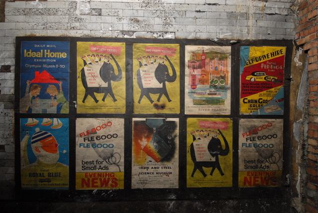 Old posters in disused passageway at Notting Hill Gate tube station, London, 2010