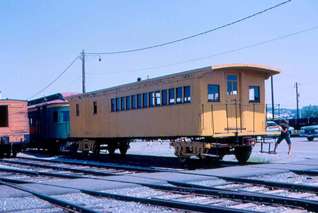 Two Railroad Cars Each Of Mass  Kg And Traveling