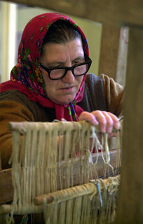 A woman weaves using a traditional loom | by World Bank Photo Collection