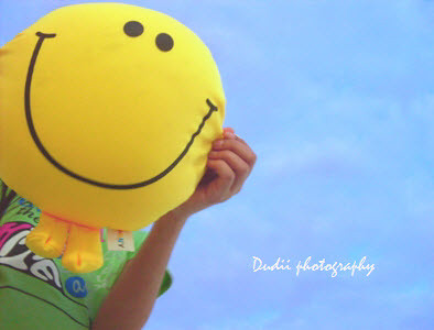 "‎Putting on a fake smile, so you don`t have 2 explain why your not happy ;'"") 