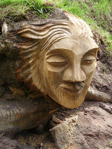 Green man carving chainsaw of a by
