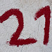 Number 21 written in red on wall