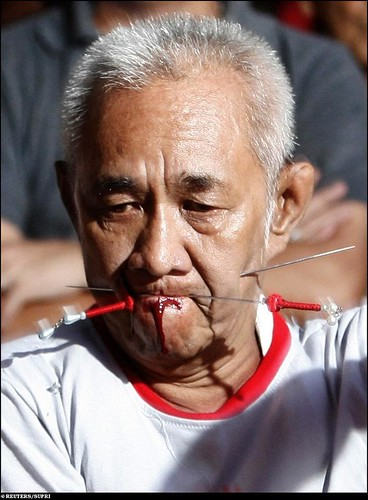 Indonesia an ethnic chinese man pierces his mouth with for Van der leun rijssen