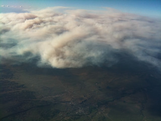 Aerial photo of forest fire smoke | by adamtpeterson