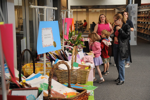 Looking through books on display for the 4th Annual Children's Reading Celebration and Young Authors' Fair | by California State University Channel Islands