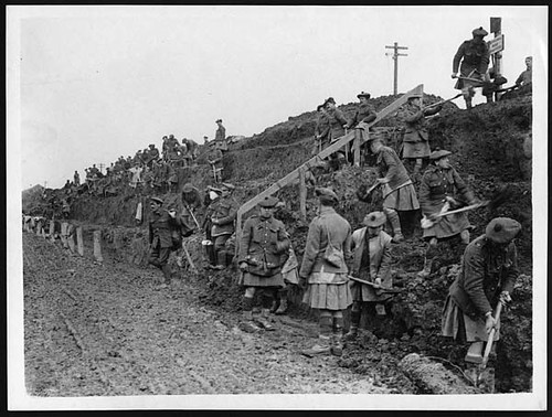 Highlanders at work broadening a road | by National Library of Scotland