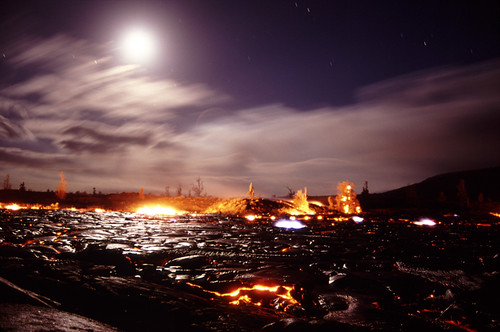 Alien World- Lava destroying vegetation in the moonlight | by volcanoimage