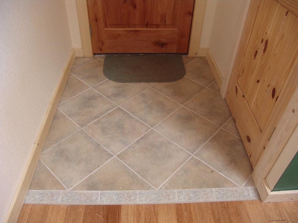 Foyer Tile Job : Porcelain tile entry with custom