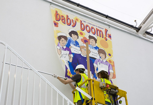 04 baby boom banner install king 39 s mill hospital murals for Baby boom salon