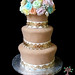 carob fondant covered wedding cake with gumpaste flowers and fondant lace painted with edible gold paint