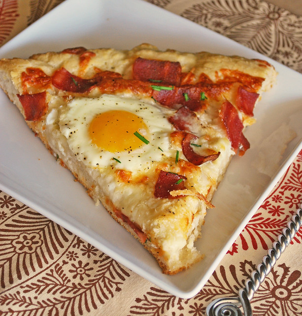 Breakfast Pizza - pizza with bacon, 2 kinds of cheese, runny eggs, and chives on top! Perfect for breakfast for dinner!