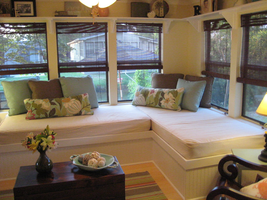 Small space solution sunroom corner with built in beds Florida sunroom ideas