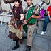 Steampunk Couple With Large Wrench and Hammer