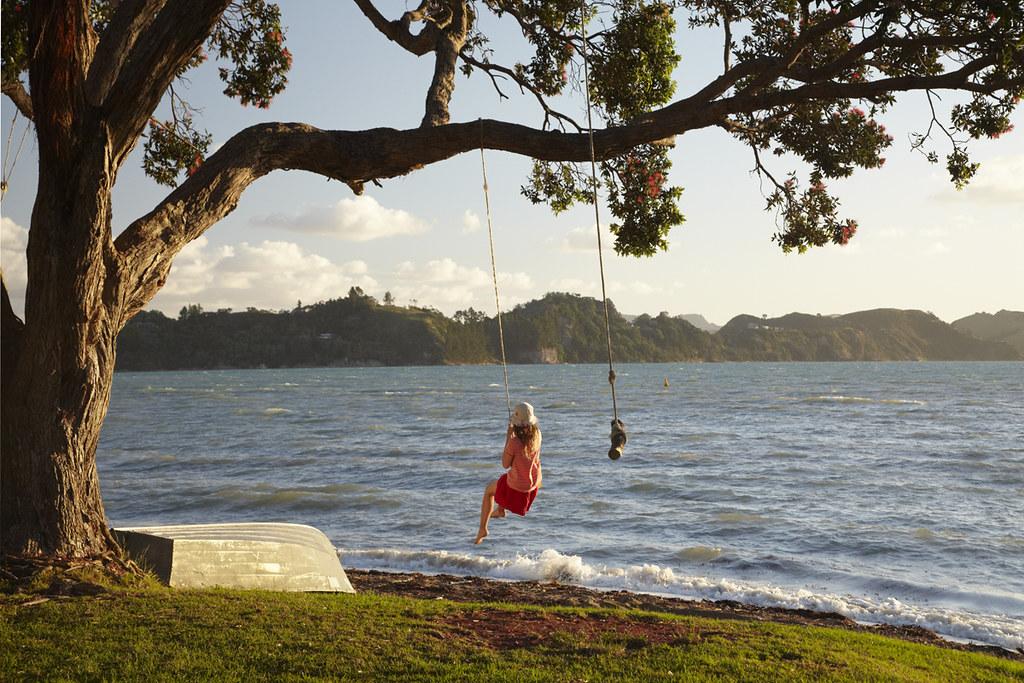 Young Girl on Rope Swing under Pohutukawa Tree, Oamaru Bay ...