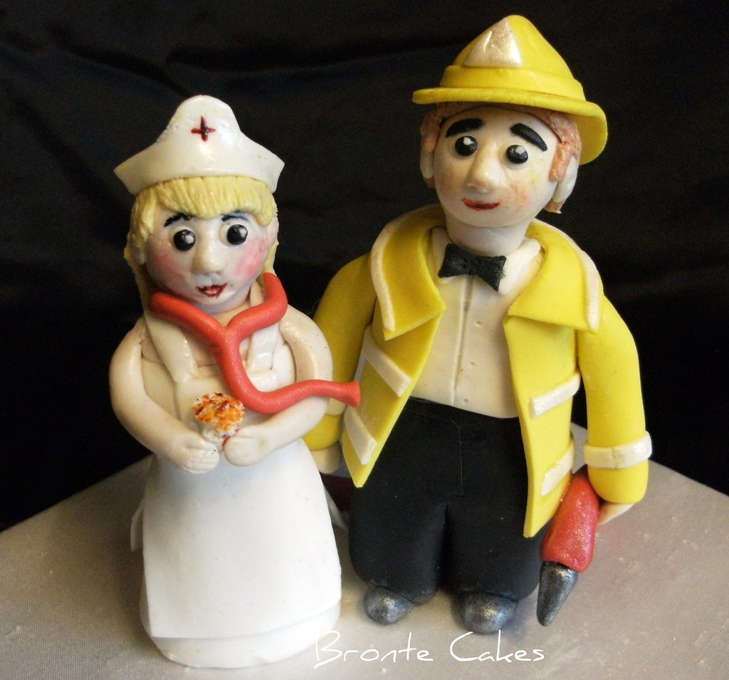 Nurse n Firefighter wedding topper | Made for a couple who a… | Flickr