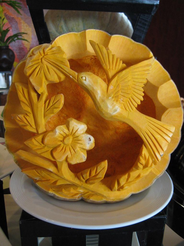 Humming bird food carving a pumpkin display at