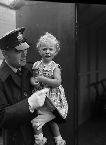 National Eisteddfod of Wales, Ebbw Vale, 1958 : A policeman with a lost child | by LlGC ~ NLW
