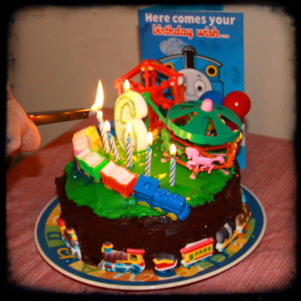 Birthday Cake Images For 6 Year Old Boy : lighting the birthday candles on fun carnival train 6 year ...