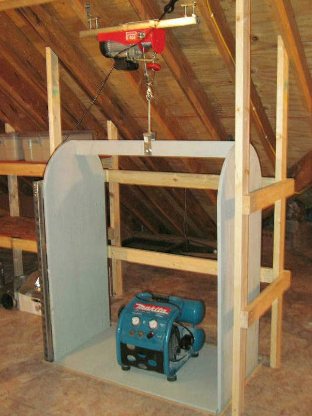 Attic lift above the lift carriage in the fully raised for Diy home elevator plans