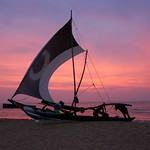 Fishermen & their boat, at sunset in Negombo