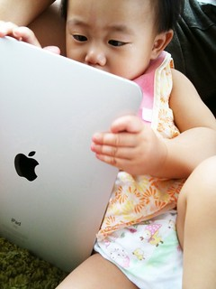 baby using iPad | by kenleewrites