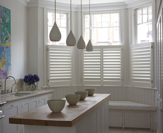 Kitchen shutters interior shutters from the new england for Indoor wood shutters white