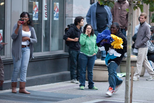 Looter Runs Down Broadway With Items Taken From Foot Locker, Oakland Riots, 2010 | by Thomas Hawk