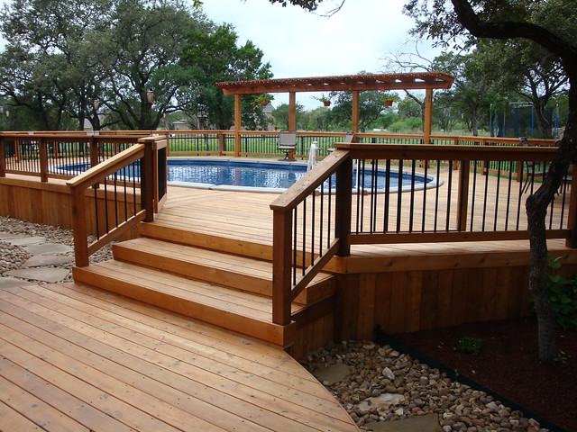 Oval above ground pool with wooden deck entrance bexar for Above ground oval pool deck plans