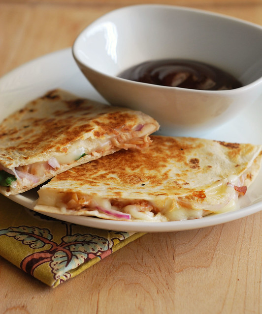BBQ Chicken Quesadillas - chicken, mozzarella cheese, red onion, cilantro, and barbecue sauce stuffed into a flour tortilla and grilled until golden and crispy! Super easy and fast weeknight meal!